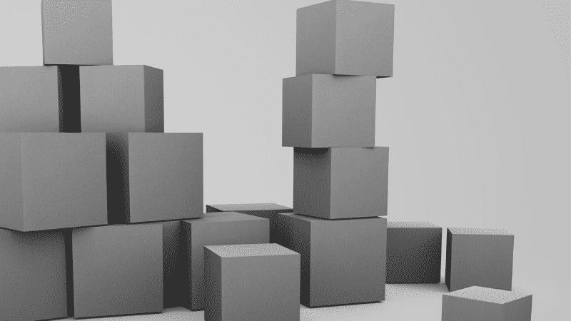 TOEICパート1の例題を紹介するための写真。d段ボールが積み上げられている様子が映し出されている。この写真の説明として正しいものを次の4つの中から選ぶ。